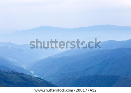 blue forest hills of the Carpatian mountains - stock photo