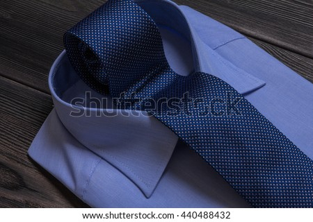 blue formal shirt and rolled necktie in collar - stock photo