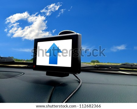 Blue forward arrow on gps system in car - stock photo
