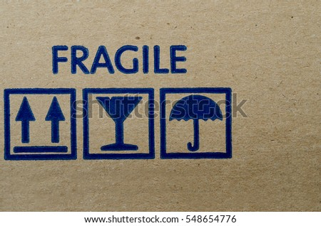Blue fragile symbol on cardboard