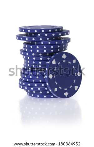 Blue gambling chips on white background - stock photo