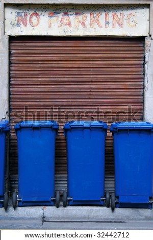 Blue garbage bins in a row - stock photo