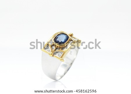 Blue gemstone ring isolated on white background