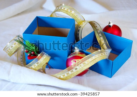 Blue gift box with Christmas decorations and sparkling lights - stock photo