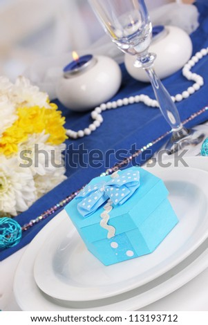 Blue gift for guests on wedding table close-up - stock photo