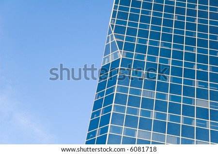 blue glass building reflecting blue sky - stock photo