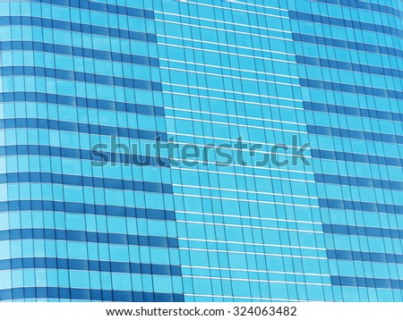 blue glass wall of skyscraper, abstract background. - stock photo