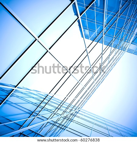 blue glass wall of skyscraper perspective view - stock photo