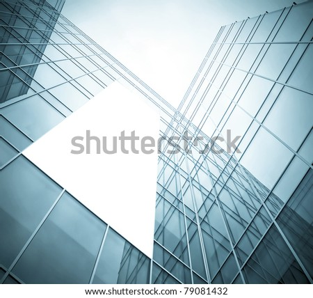 blue glass wall with blank placard of skyscraper - stock photo