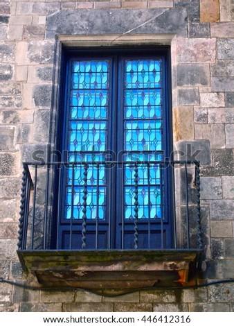 Blue glass window with Juliet balcony in Barcelona, Spain - stock photo