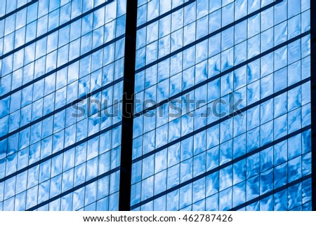 Blue glass windows of office building for background