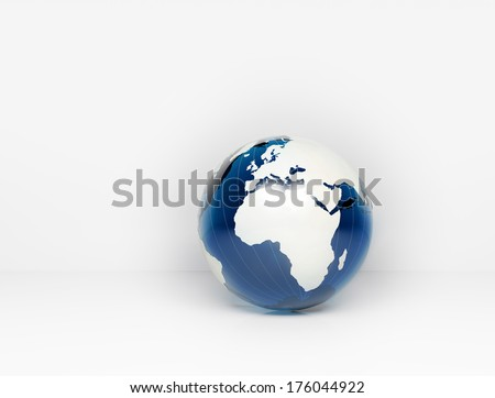 Blue glass world globe and wall background