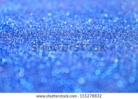 Blue glitter sparkle confetti background for Christmas or New Year's Eve - stock photo