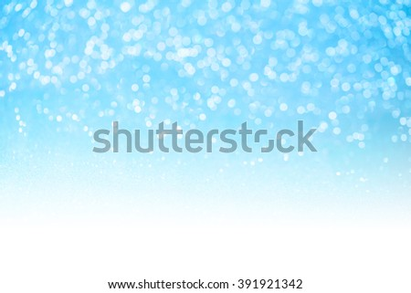 Blue glitter surface with blue light bokeh with white copy space - It can be used for background for special occasions promotion campaign or product display - stock photo
