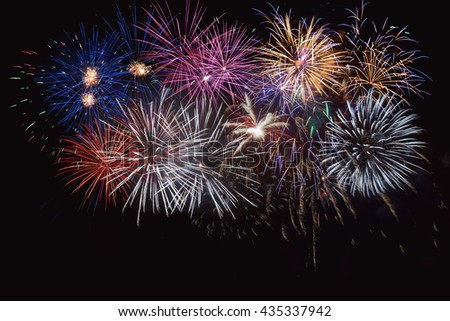 Blue, golden and red celebration fireworks. 4th of July beautiful fireworks. Independence Day, Canada Day, New Year holidays salute.  - stock photo