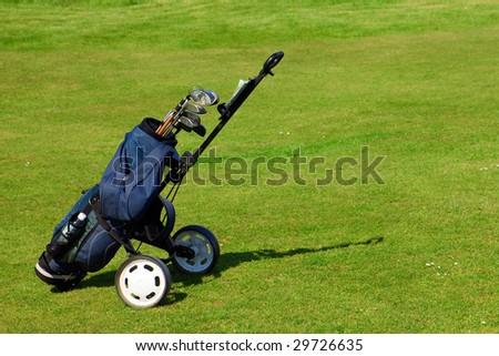 Blue golf bag on green fairway - stock photo