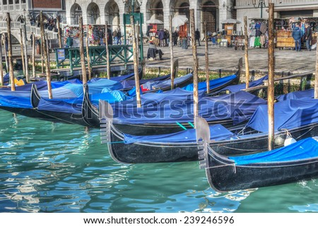 blue gondolas by San Marco shore in Venice, Italy. Processed for hdr tone mapping effect. - stock photo