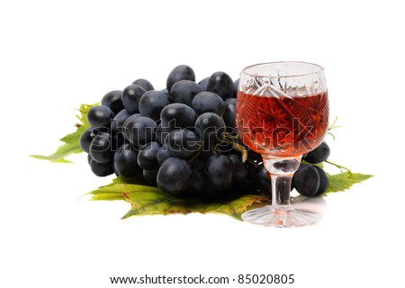 Blue grapes and red wine isolated on white background