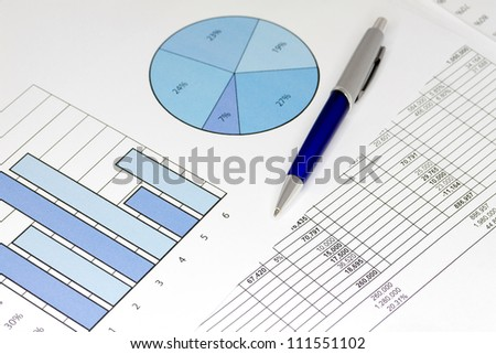 Blue Graphs with Spreadsheet and Pen - stock photo