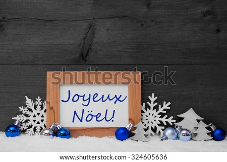 Blue Gray Decoration On Snow. Christmas Tree Balls, Snowflake And Christmas Tree. Picture Frame. French Text Joyeux Noel Mean Merry Christmas. Rustic, Vintage Brown Wooden Background. Black And White - stock photo