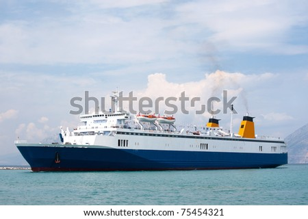 Blue Greek ferry boat at the sea - stock photo