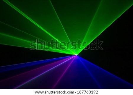 Blue, green, and red laser beams - stock photo