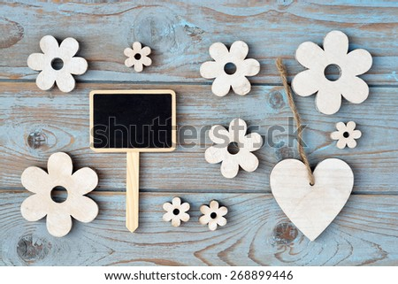 blue grey background with wooden hearts and flower and with love, for you label and chalkboard - stock photo