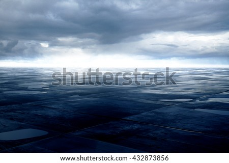 Blue grunge ground with small puddles under cloudy sky. 3D Rendering - stock photo
