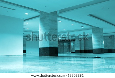 Blue hall with square columns - stock photo