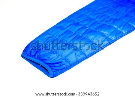 blue hand of warm light weight  insulated  jacket  on white background. - stock photo