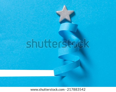 blue, handmade Christmas tree cut out from paper, simple and effective solution - stock photo