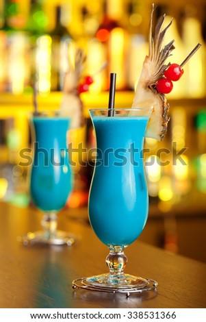 Blue Hawaiian cocktails shot on a bar - stock photo