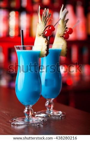 Blue Hawaiian cocktails shot on a bar in a club - stock photo