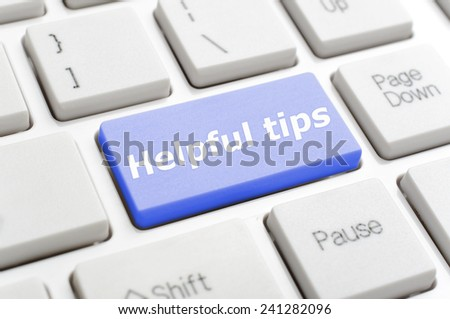 Blue helpful tips key on keyboard