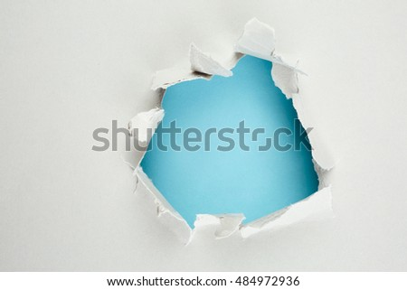Blue hole in paper. Abstract background