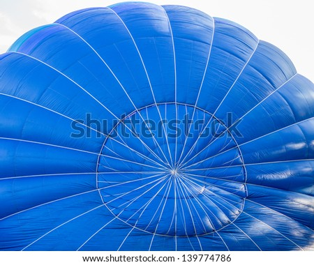 Blue Hot air balloon inside - stock photo