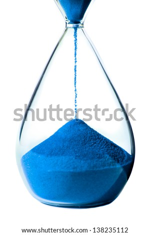 Blue hourglass on white background. - stock photo
