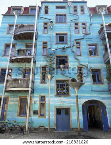 blue house facade including lots of art elements seen in Dresden (Saxony, Germany) - stock photo
