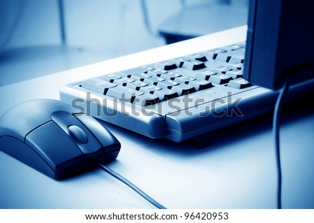 Blue hue of the keyboard and mouse, close-up closeup.