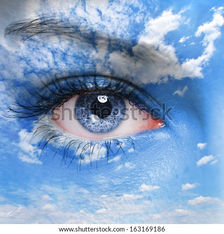 Blue human eye and cloudy sky on face - stock photo