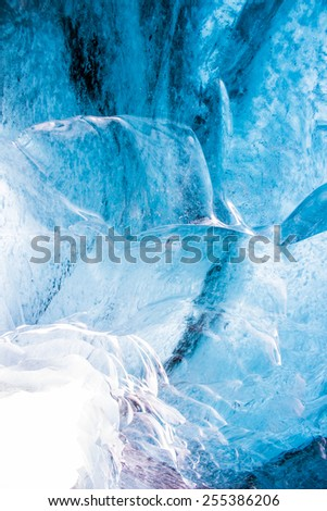 Blue ice cave view background in Iceland - stock photo