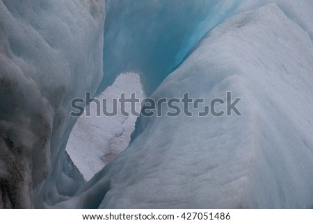 Blue ice, frozen ice, and white combine at a glacier