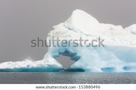 Blue icebergs of Greenland. The most ancient continental ice. Fantastic foggy landscapes. - stock photo