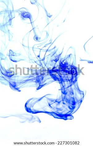 Blue ink in water on a white background. - stock photo