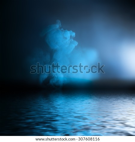 Blue ink reflected in water surface. Conceptual photo. - stock photo