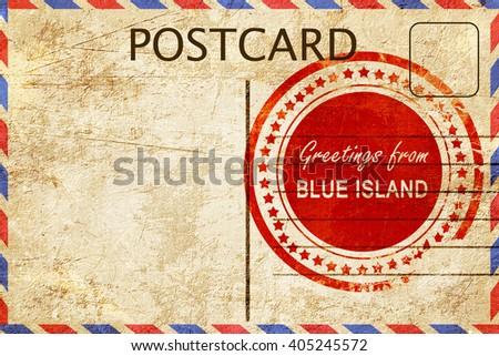 blue island stamp on a vintage, old postcard - stock photo