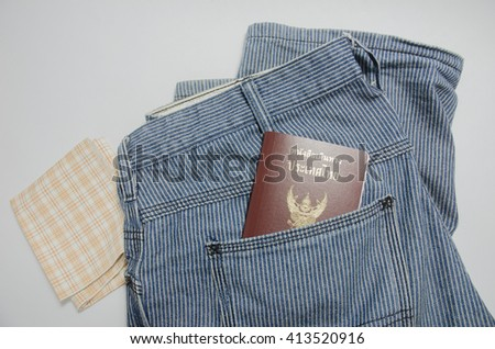 blue jean and passport in pocket - stock photo