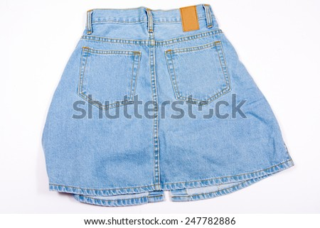 Blue jean shorts with a white background - stock photo