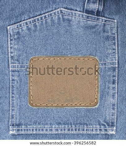 Blue jeans background texture with leather label