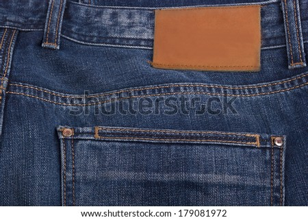 Blue jeans fabric with back pocket and a label background - stock photo